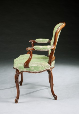 A Set of Four George III Mahogany Armchairs attributed to John Cobb shown in profile
