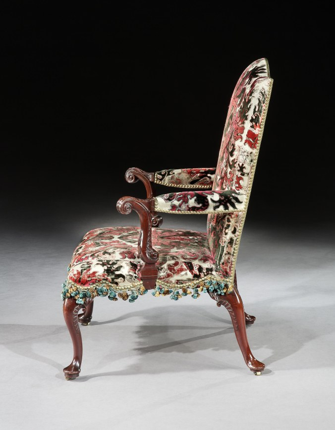 A Pair of George II Mahogany Armchairs from Warwick Castle shown in profile Mackinnon Fine Furniture Collection