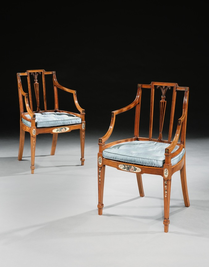A pair of satinwood armchairs in the manner of George Hepplewhite Mackinnon Fine Furniture Collection