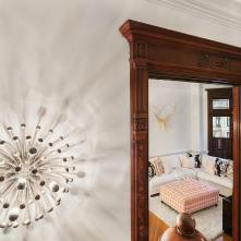 Detail of architectural door mouldings with contemporary light fixture