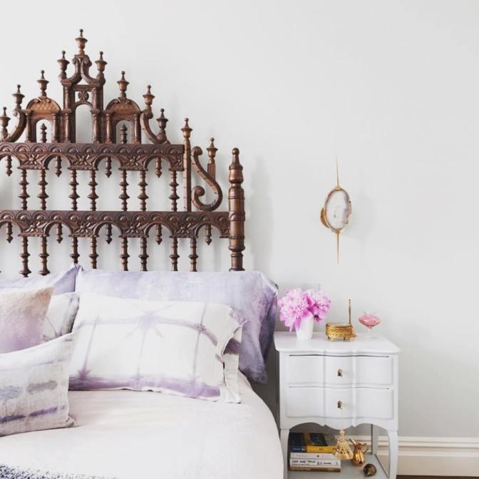 A Portuguese Gothic headboard in a modern bedroom