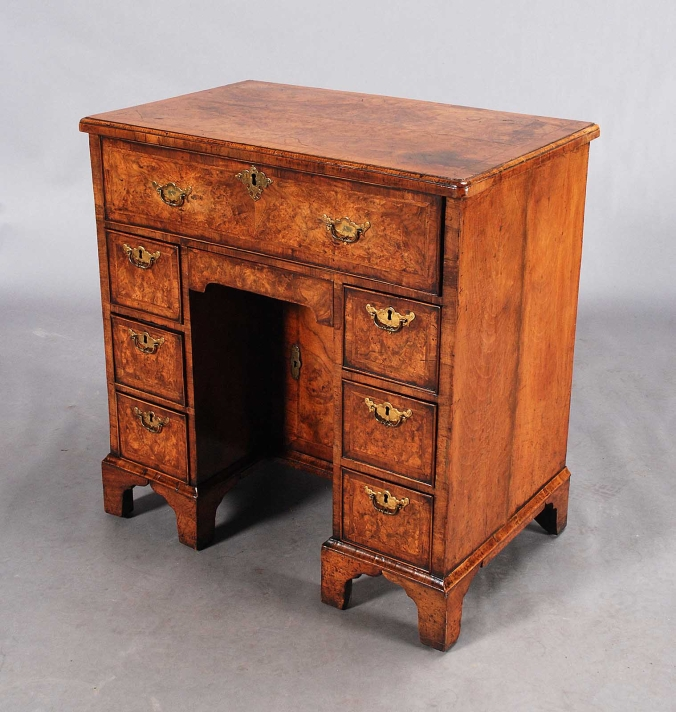 A George II burr walnut kneehole desk Mackinnon Fine Furniture Collection
