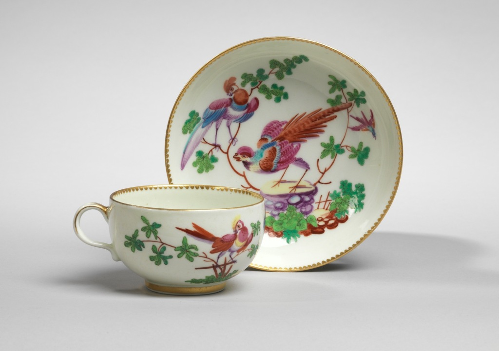 A Worcester cup and saucer with exotic birds Mackinnon Fine Furniture Collection
