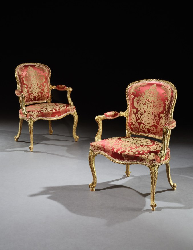 A Pair of George III Carved Giltwood Armchairs attributed to John Cobb Mackinnon Fine Furniture Collection