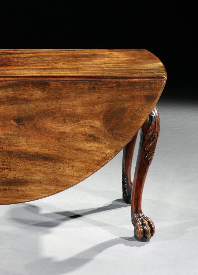 Detail of a lion's paw foot on a George II Irish Mahogany Drop Leaf Table Mackinnon Fine Furniture Collection