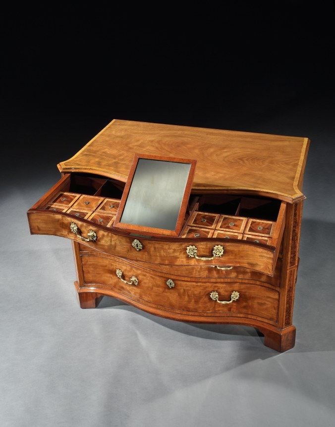 A George III Mahogany Chest of Drawers in the manner of Thomas Chippendale Mackinnon Fine Furniture Collection