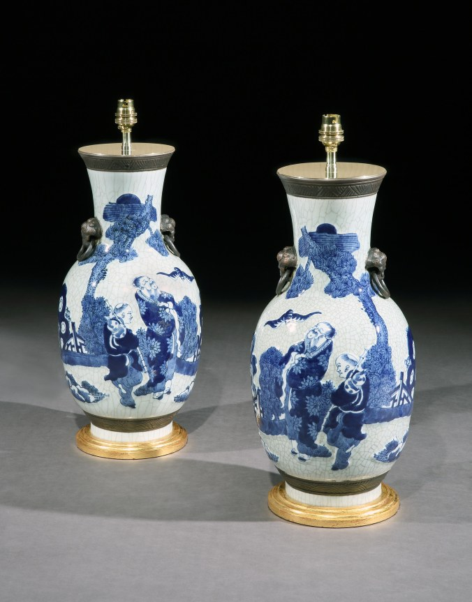 A Pair of Chinese Blue and White Vases on a Celadon Ground Mackinnon Fine Furniture Collection