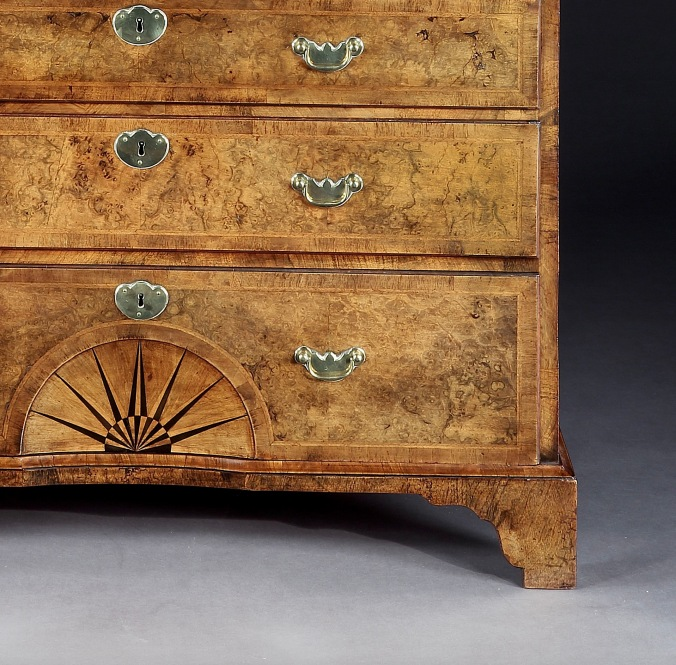 Detail of a George I burr walnut chest on chest with bracket feet Mackinnon Fine Furniture Collection